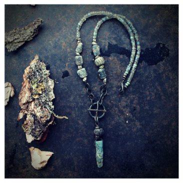 Handmade amulet jewellery: solar cross kyanite necklace Käsintehty amulettikoru: aurinkoristi kyaniittikaulakoru
